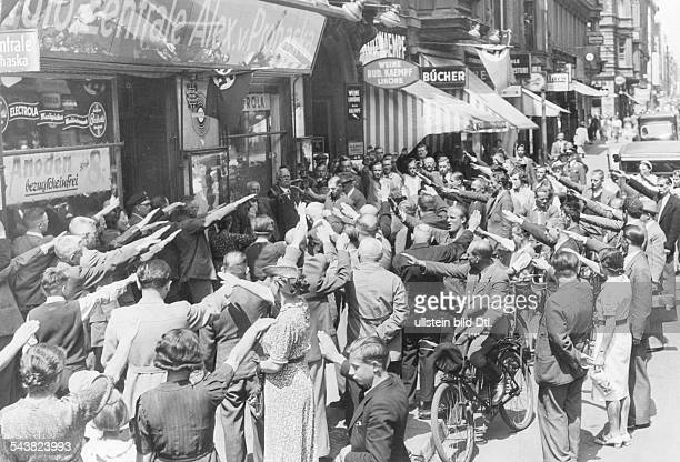 A radio shop in Berlin announcing the capture of Paris by German troups people outside the shop show the Nazi salute