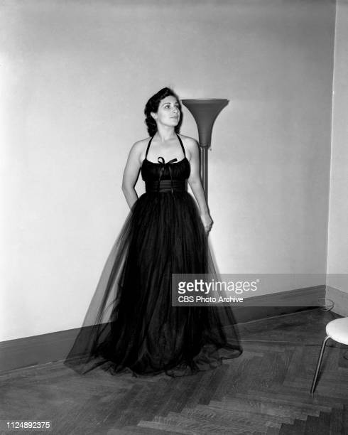 Radio singer Bea Wain models a bouffant black tulle evening gown selected by fashion stylist and critic Elizabeth Hawes. Image dated: September 18...