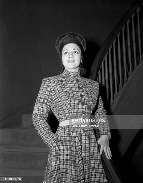Radio singer Bea Wain models a plaid tweed suit selected by fashion stylist and critic Elizabeth Hawes. Image dated: September 18 New York NY.
