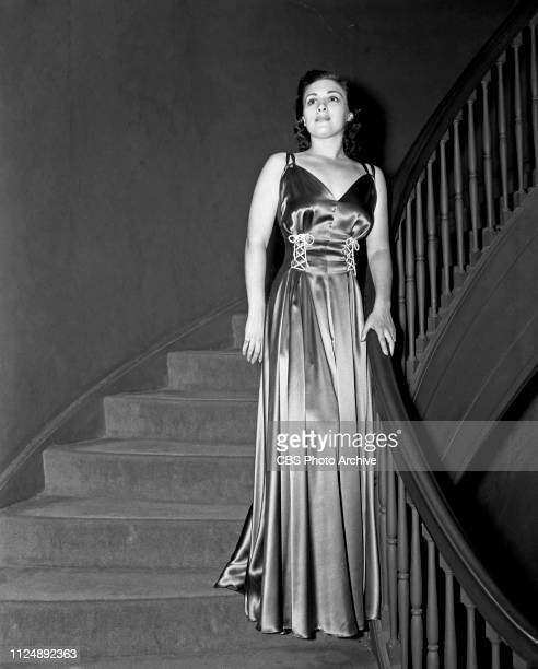Radio singer Bea Wain models a satin evening dress selected by fashion stylist and critic Elizabeth Hawes. Image dated: September 18 New York NY.