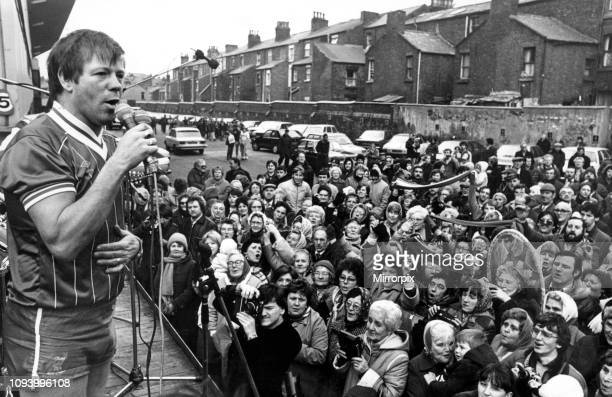 Radio star Billy Butler entertains a crowd of 300 fans at Anfield with a version of Top anthem 'You'll Never Walk Alone' Clad in a Liverpool FC strip...