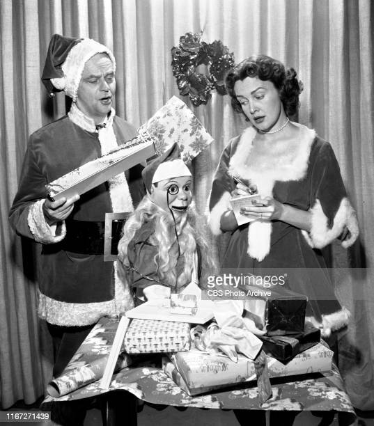Radio talent Edgar Bergen Charlie McCarthy Frances Bergen They prepare for Operations Santa Claus a charitable effort in bringing entertainers and...