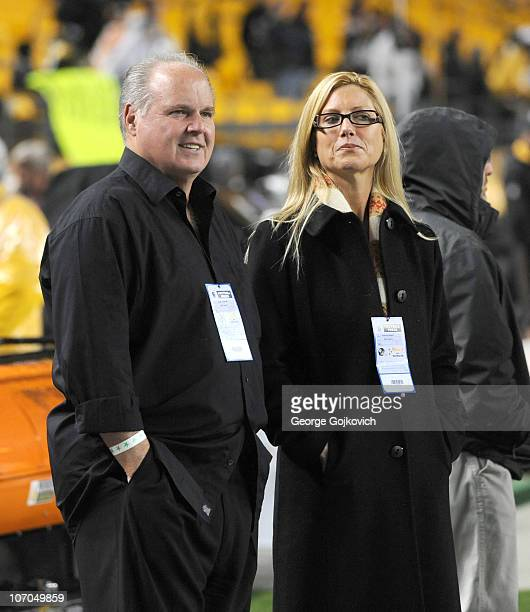 Radio talk show host and political commentator Rush Limbaugh and his wife Kathryn Rogers look on from the sideline before a National Football League...