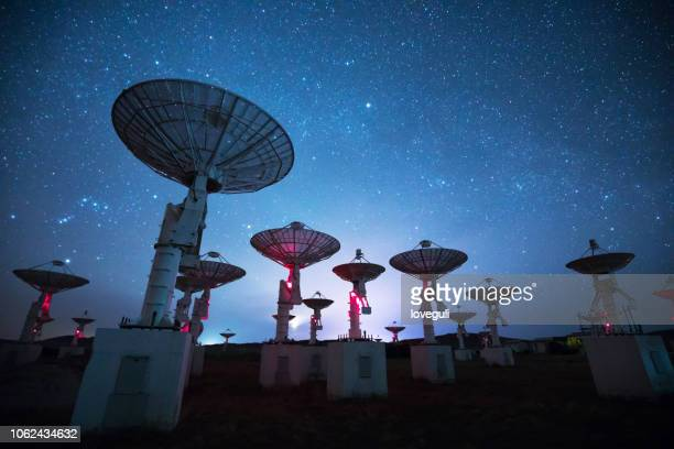 radio telescope at night - satellite dish stock pictures, royalty-free photos & images