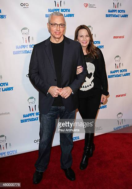 Radio / TV Personality Drew Pinsky and his wife Susan Pinsky attend a surprise party for Larry King's 80th Birthday at Dodger Stadium on November 15...