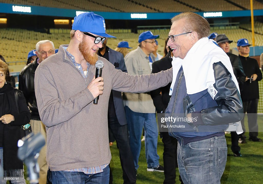 Radio / TV Personality Larry King (R) and L.A. Dodger J. P. Howell attend a surprise party for Larry King's 80th Birthday at Dodger Stadium on November 15, 2013 in Los Angeles, California.