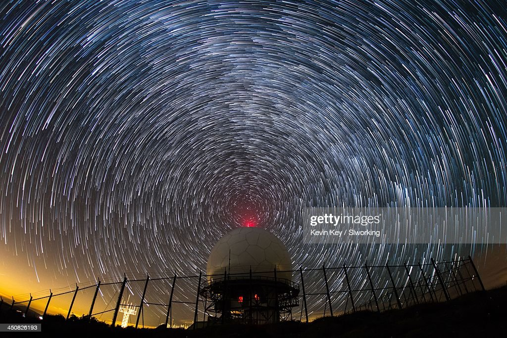Radio waves. Star trails around radar dome : Stock Photo