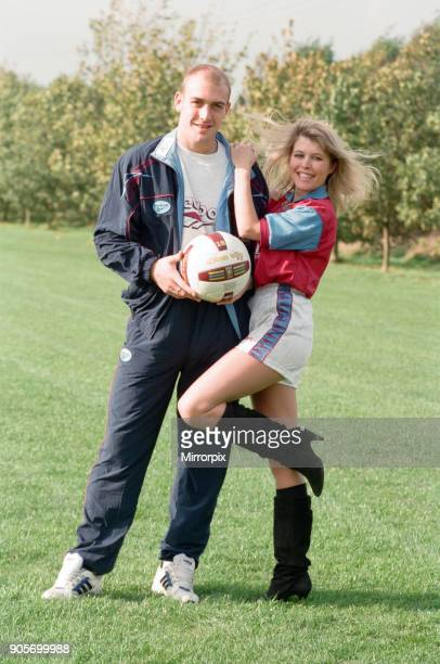 BBC Radio WM presenter Julie Mayer in an Aston Villa kit with Villa midfielder Mark Draper at the club's Bodymoor Heath training ground This is part...