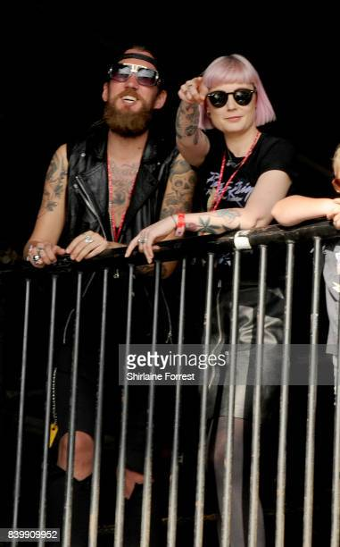 Radio X DJ Sunta Templeton watches bands at Leeds Festival at Bramhall Park on August 27, 2017 in Leeds, England.
