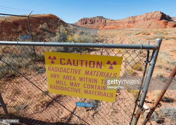 A radioactive warning sign hangs on fencing around the Anfield's Shootaring Canyon Uranium Mill on October 27 2017 outside Ticaboo Utah Anfield with...