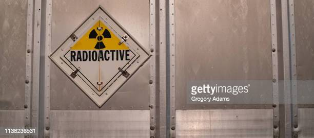 radioactive warning sign on the back of a truck - uranium stock pictures, royalty-free photos & images