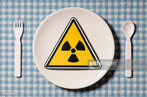 radioactivity symbol on plate - plastic plate stock photos and pictures
