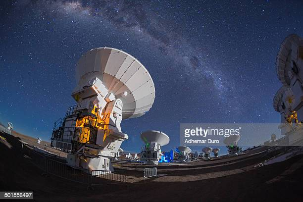 Radioastronomy antennas apparently pointed to the Milky Way at Chajnantor, ALMA Observatory, Chile, 2014.