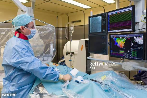 Radiofrequency ablation of cardiac arrhythmia using the Stereotaxis robotic system by inserting a catheter into the heart emitting radio waves that...