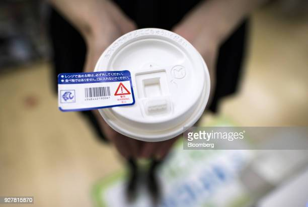 A radiofrequency identification tag attached to a cup of coffee is arranged for a photograph at a FamilyMart UNY Holdings Co FamilyMart convenience...
