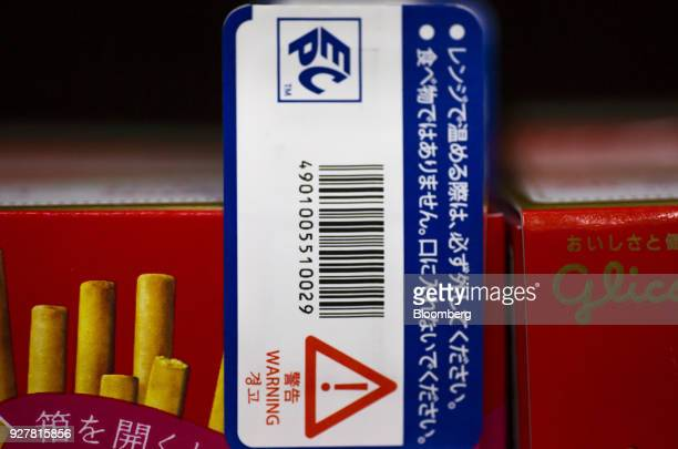 A radiofrequency identification tag is attached to a box of Ezaki Glico Co Pocky chocolate confectionery at a FamilyMart UNY Holdings Co FamilyMart...