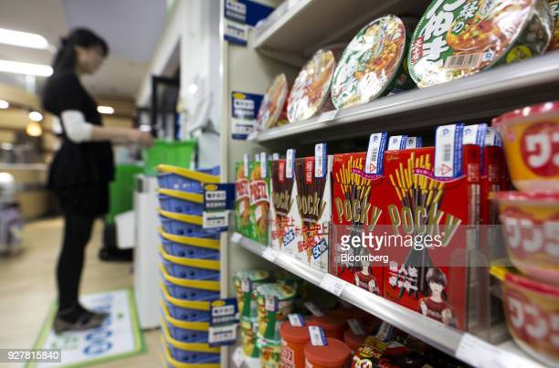 Radiofrequency identification tags are attached to boxes of Ezaki Glico Co Pocky chocolate confectionery at a FamilyMart UNY Holdings Co FamilyMart...