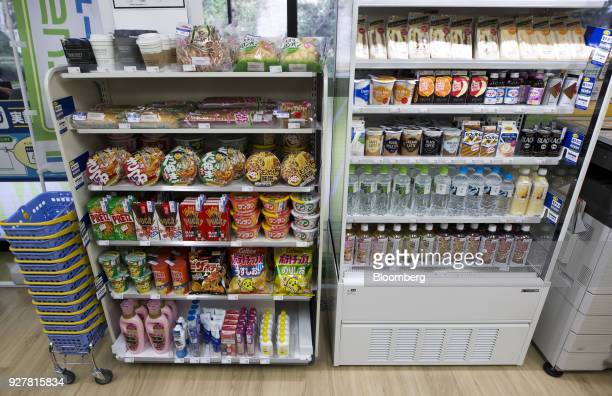 Radiofrequency identification tags are attached to products displayed on shelves at a FamilyMart UNY Holdings Co FamilyMart convenience store in...