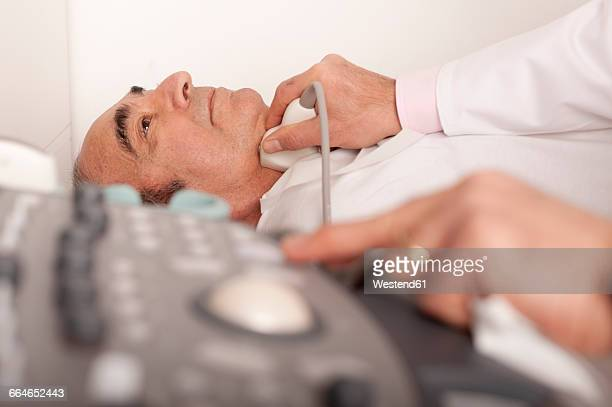 radiologist examining carotid with ultraschall - cervix stock pictures, royalty-free photos & images