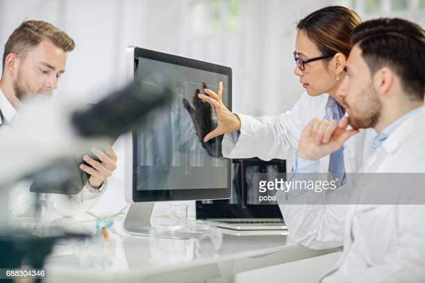 radiologist examining X-ray image on computer