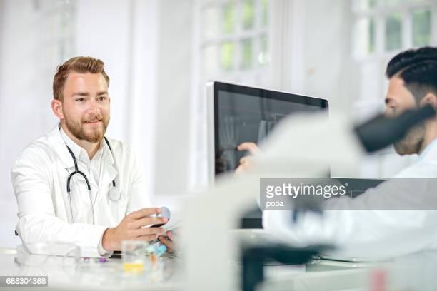 radiologist examining X-ray image on computer