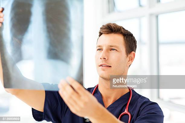 Radiologist Examining X-Ray In Hospital