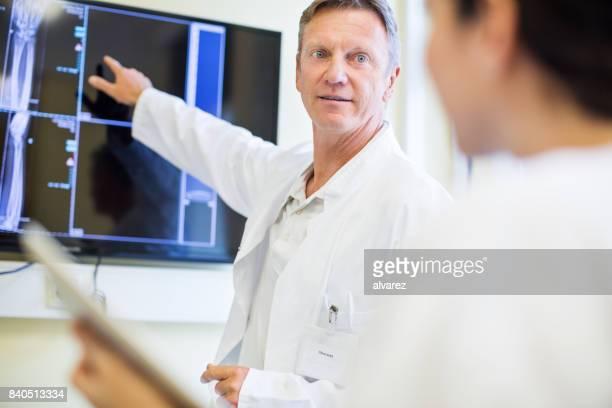 Radiologist explaining medical scan results to nurse