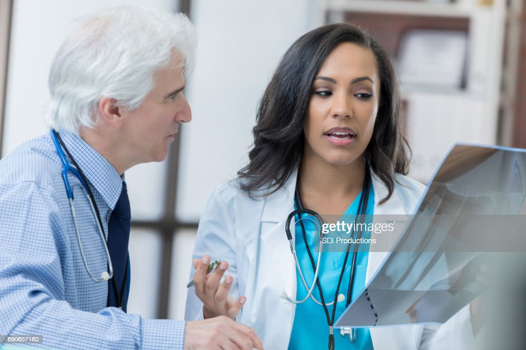 Radiologists examine a patient's x-ray : Stock Photo