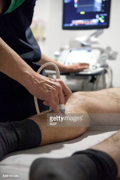 Radiology center France radiologist carries out a Doppler ultrasound on a patient with varicose veins