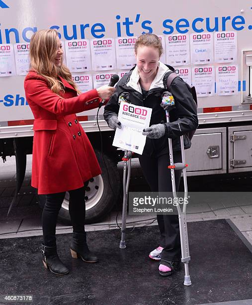 Radio/TV personality Allison Hagendorf talks to an attendee who is ready to shed her crutches in 2015 at The 'Good Riddance Day' Event at Times...