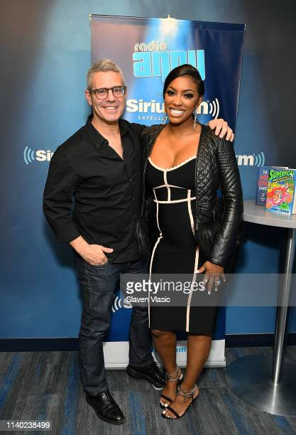 Radio/TV personality Andy Cohen and TV personality Porsha Williams pose for photos at Radio Andy SiriusXM Studios on April 29, 2019 in New York City.
