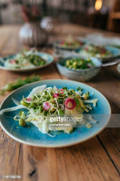 radish salads with red onion, edamame beans and bean sprouts - portie stockfoto's en -beelden