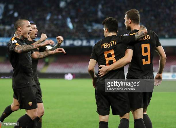 Radja Nainggolan Diego Perotti and Edin Dzeko of AS Roma celebrate the 12 goal scored by Edin Dzeko during the serie A match between SSC Napoli and...
