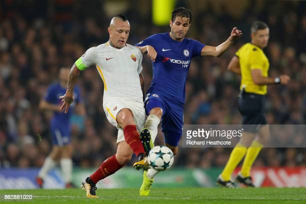 Radja Nainggolan of AS Roma and Cesc Fabregas of Chelsea battle for possession during the UEFA Champions League group C match between Chelsea FC and...