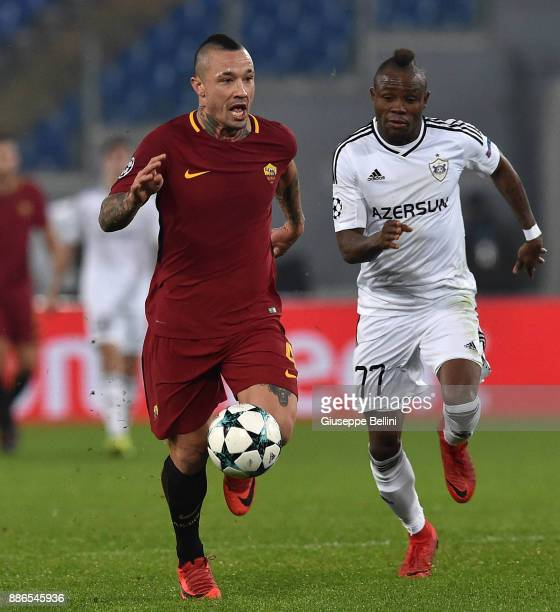 Radja Nainggolan of AS Roma and Donald Guerrier of Qarabag FK in action during the UEFA Champions League group C match between AS Roma and Qarabag FK...