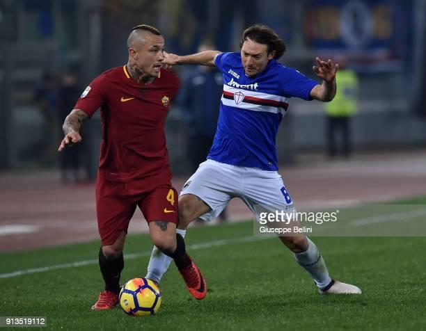 Radja Nainggolan of AS Roma and Edgar Osvaldo Barreto of UC Sampdoria in action during the serie A match between AS Roma and UC Sampdoria at Stadio...
