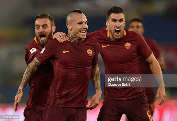 Radja Nainggolan of AS Roma celebrates with Daniele De Rossi and Kevin Strootman after scoring the opening goal during the Serie A match between AS...