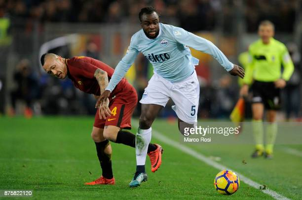 Radja Nainggolan of AS Roma compete for the ball with Jordan Lukaku of SS Lazio during the Serie A match between AS Roma and SS Lazio at Stadio...