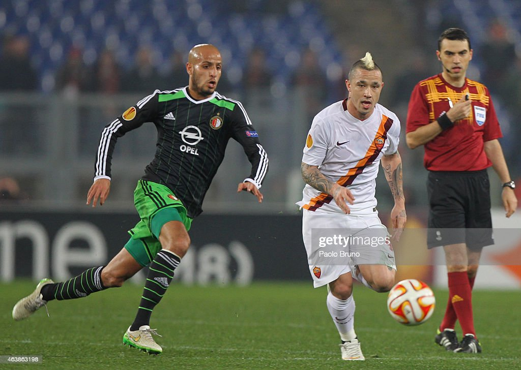Radja Nainggolan (R) of AS Roma competes for the ball with Karim El Ahmadi of Feyenoord during the UEFA Europa League Round of 32 match between AS Roma and Feyenoord at Olimpico Stadium on February 19, 2015 in Rome, Italy.