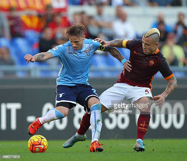 Radja Nainggolan of AS Roma competes for the ball with Lucas Biglia of SS Lazio during the Serie A match between AS Roma and SS Lazio at Stadio...