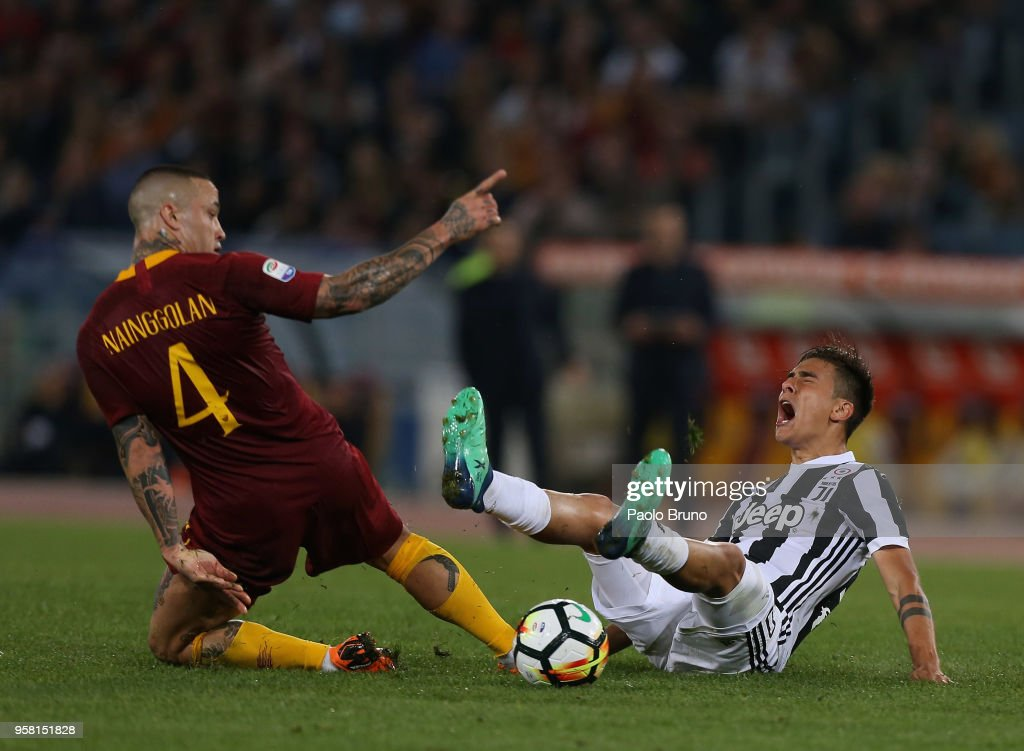 Radja Nainggolan of AS Roma competes for the ball with Paulo Dybala of Juventus during the Serie A match between AS Roma and Juventus at Stadio Olimpico on May 13, 2018 in Rome, Italy.