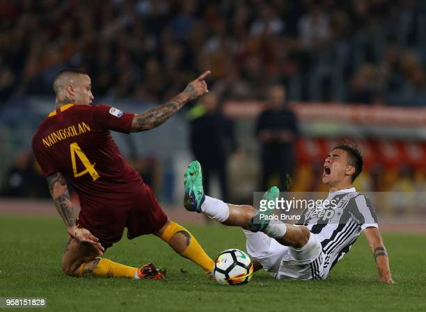 Radja Nainggolan of AS Roma competes for the ball with Paulo Dybala of Juventus during the Serie A match between AS Roma and Juventus at Stadio...