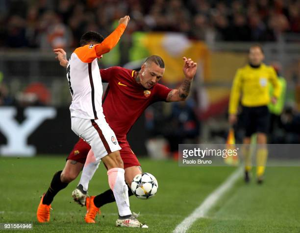 Radja Nainggolan of AS Roma competes for the ball with Taison of Shakhtar Donetsk during the UEFA Champions League Round of 16 Second Leg match...