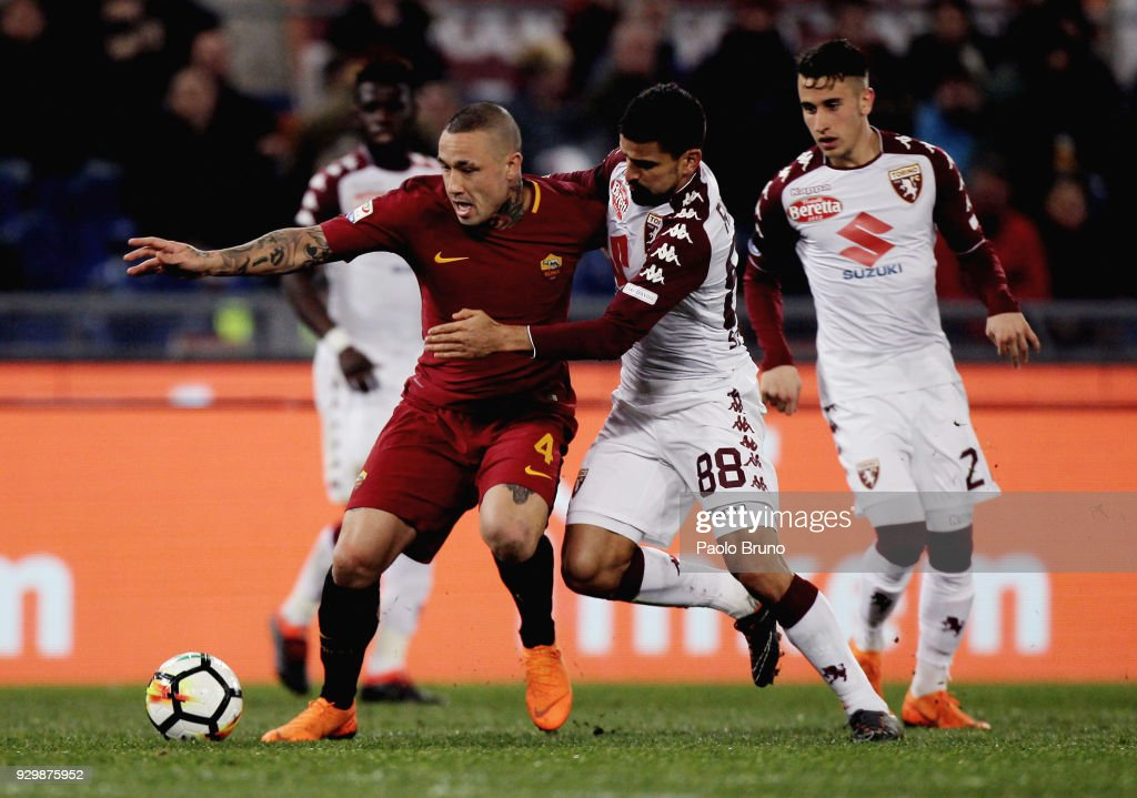Radja Nainggolan of AS Roma competes for the ball with Tomas Rincon of Torino FC during the Serie A match between AS Roma and Torino FC at Stadio Olimpico on March 9, 2018 in Rome, Italy.