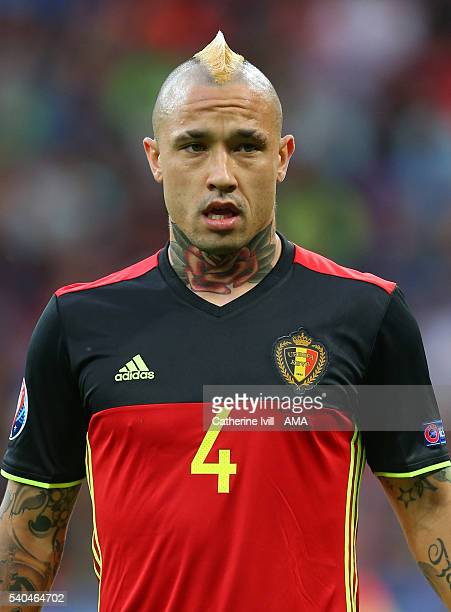 Radja Nainggolan of Belgium and the tattoo on his neck during the UEFA EURO 2016 Group E match between Belgium and Italy at Stade des Lumieres on...