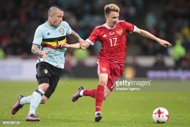 Radja Nainggolan of Belgium in action against Alexander Golovin of Russia during the friendly match between Russia and Belgium at Fisht Olympic...