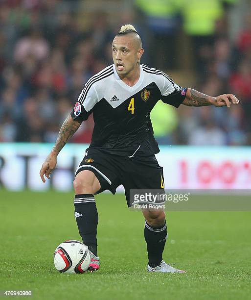 Radja Nainggolan of Belgium runs with the ball during the UEFA EURO 2016 qualifying match between Wales and Belgium at the Cardiff City Stadium on...