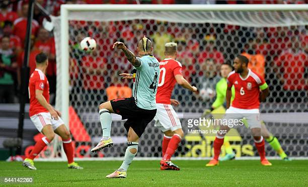 Radja Nainggolan of Belgium scores the opening goal during the UEFA EURO 2016 quarter final match between Wales and Belgium at Stade PierreMauroy on...