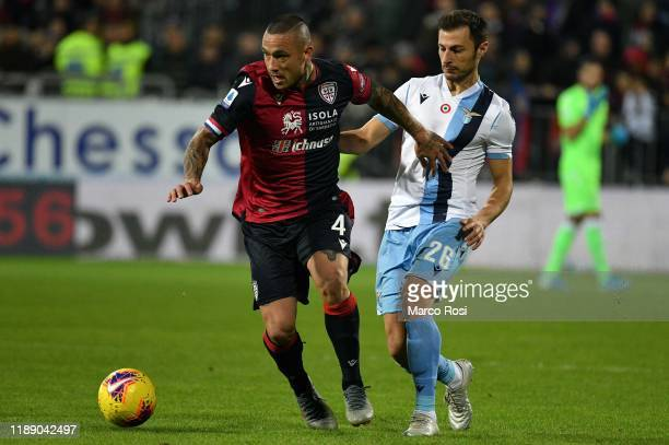Radja Nainggolan of Cagliari Calcio competes for the ball with Stefan Radu of SS lazio during the Serie A match between Cagliari Calcio and SS Lazio...