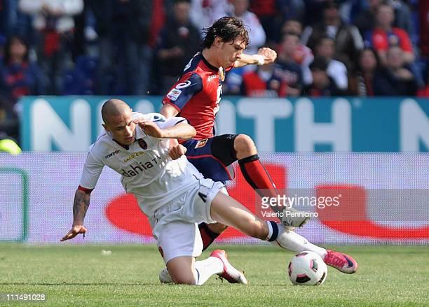 Radja Nainggolan of Cagliari Calcio is challenged by Alberto Paloschi of Genoa CFC during the Serie A match between Genoa CFC and Cagliari Calcio at...